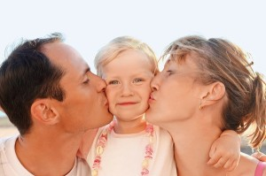 http://www.dreamstime.com/royalty-free-stock-photography-happy-family-near-to-sea-parents-kiss-daughter-image12263517